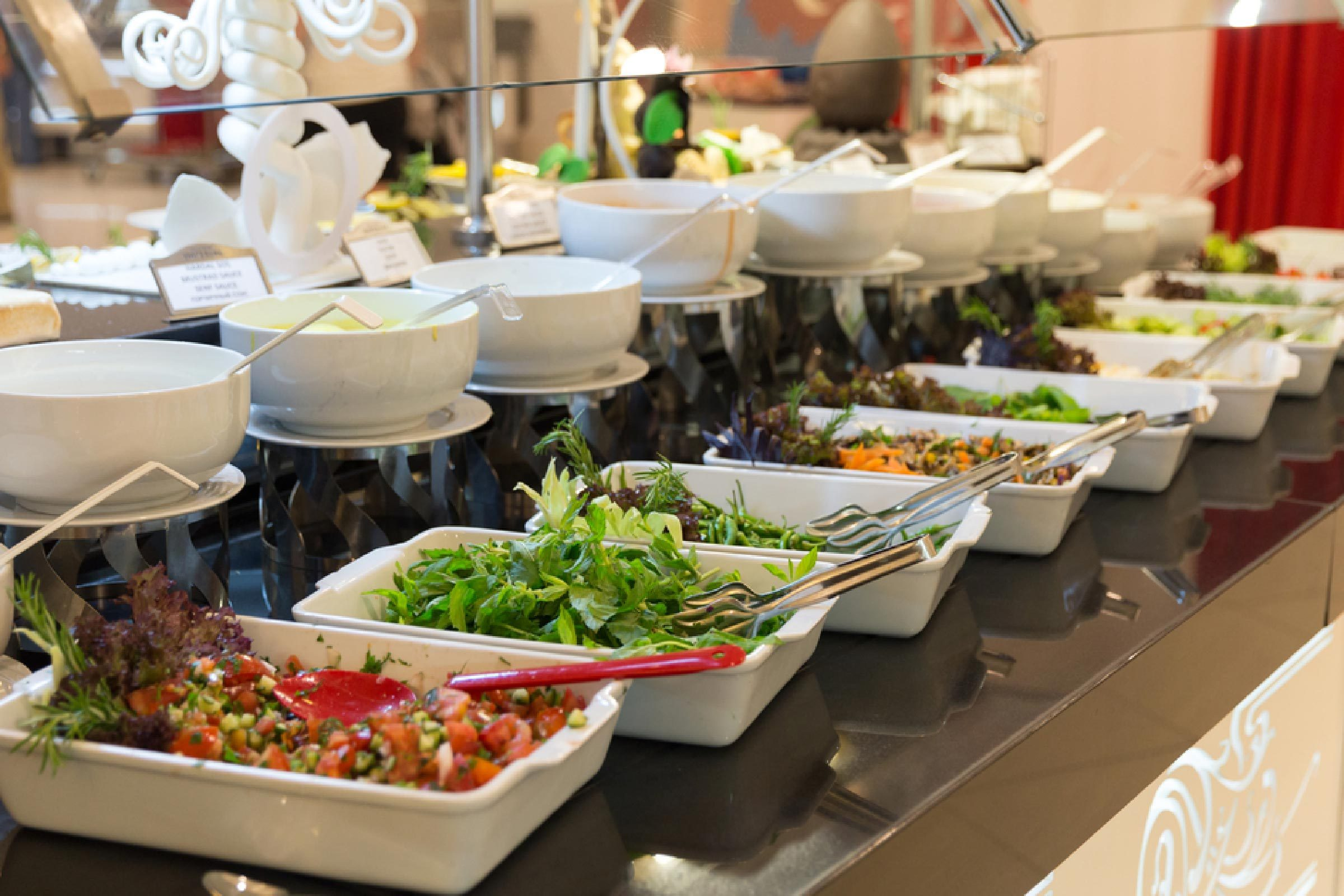 Detail of a beautiful salad buffet with a rich choice, healthy food