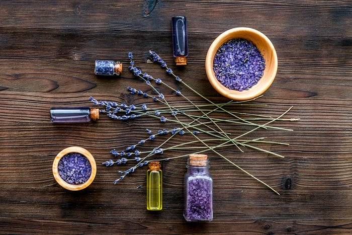 cosmetics with lavender on wooden background top view