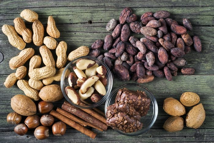 cocoa and nuts of various kinds on wooden table