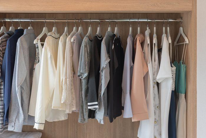 clothes hanging in closet