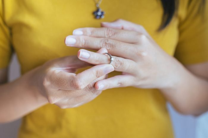 Woman push her silver wedding rings in finger