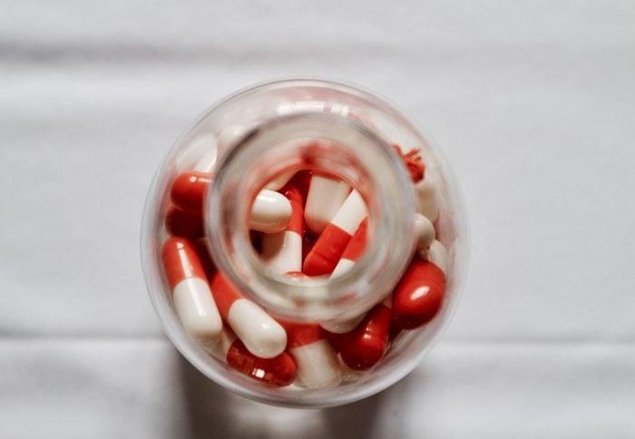 Medical healthcare, bottle of pills on white table