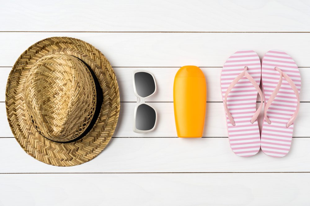 straw hat, sunglasses, sunblock, flipflops