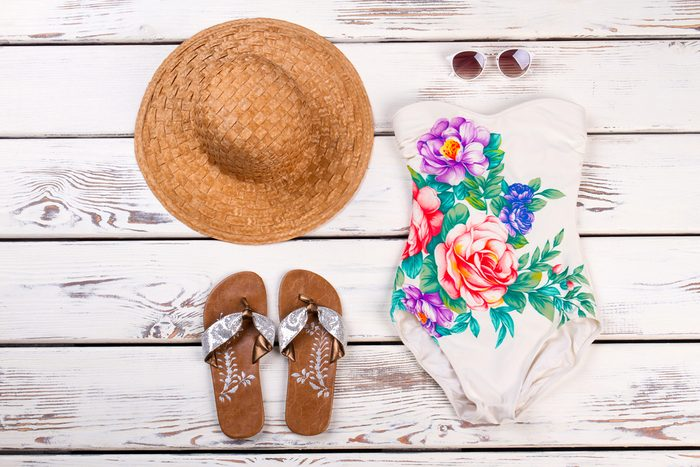 Swimsuit, sunhat, sunglasses, and sandals