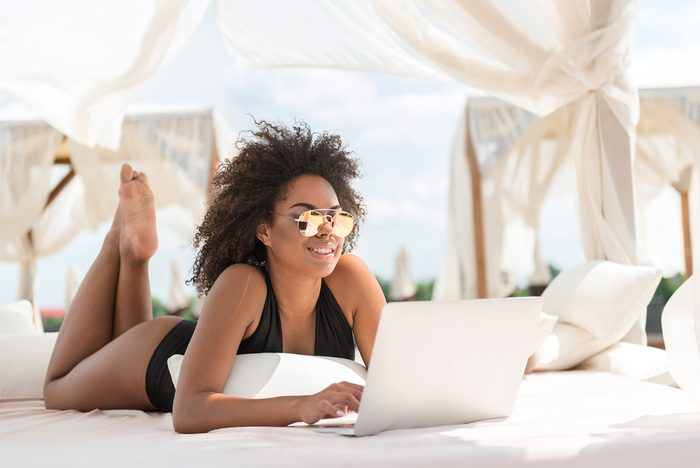 woman with laptop in summer