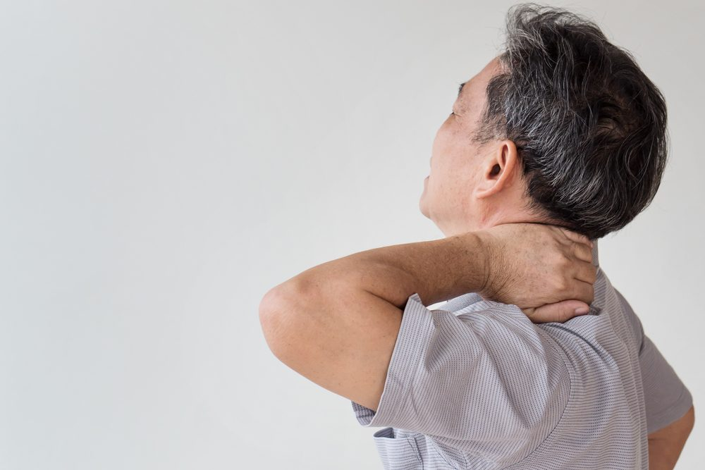 man suffering from neck, shoulder pain