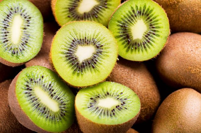 halved and whole green kiwis