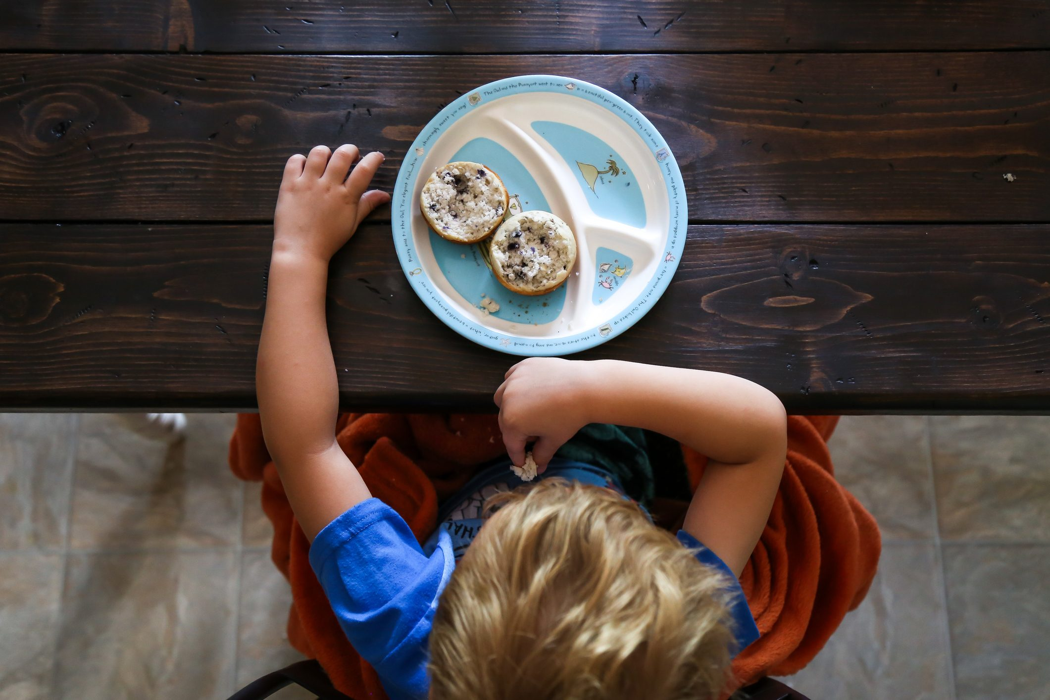 overhead shot of young boy and plate of food