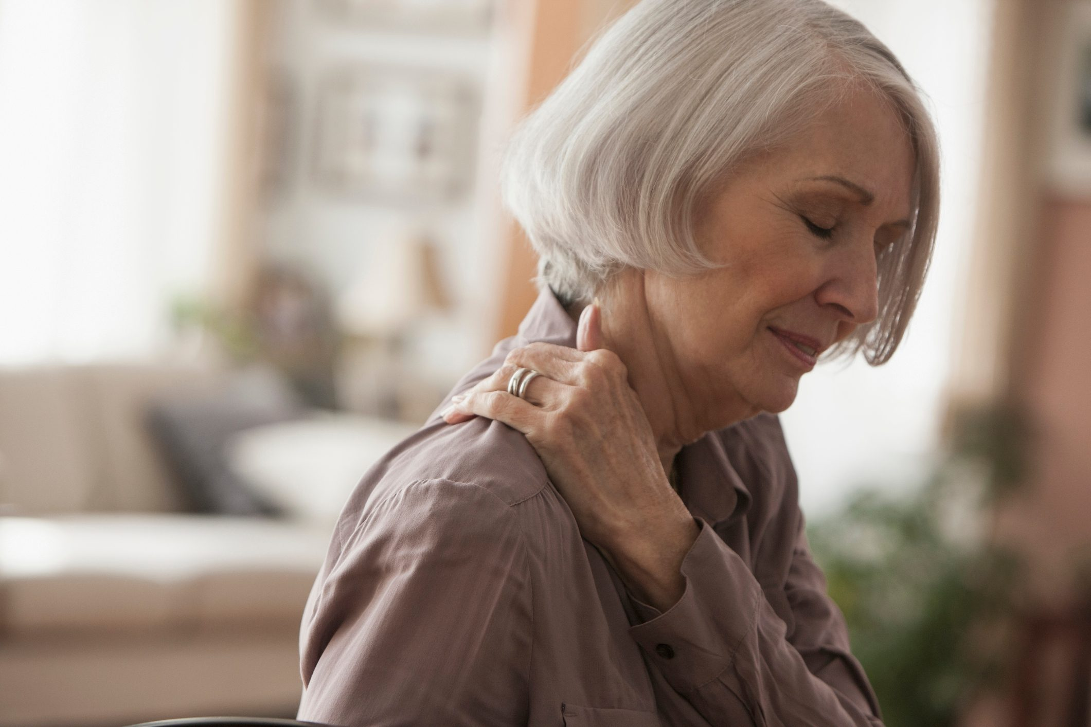 mature woman with shoulder pain