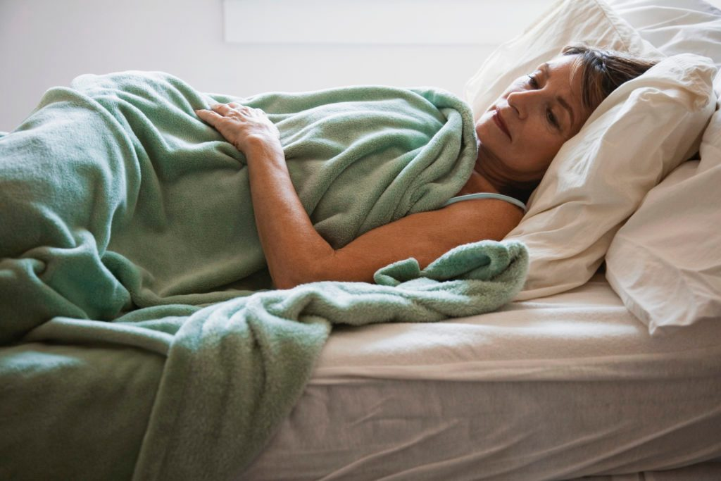 woman laying in bed awake