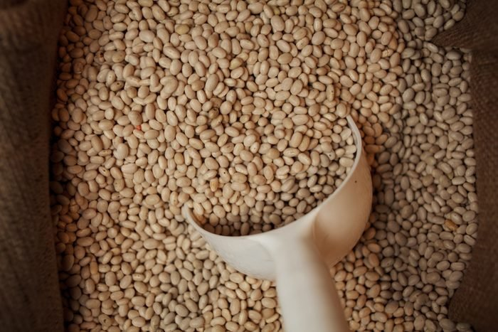 brown lentils with a scoop inside