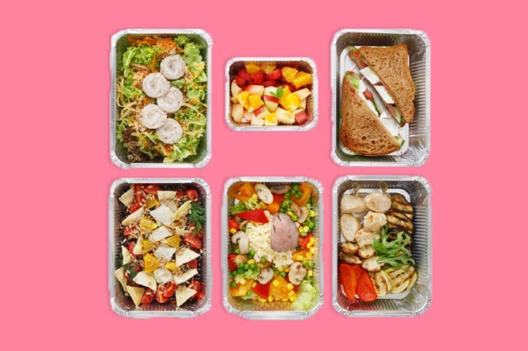 Meals and snacks portioned out in foil containers.