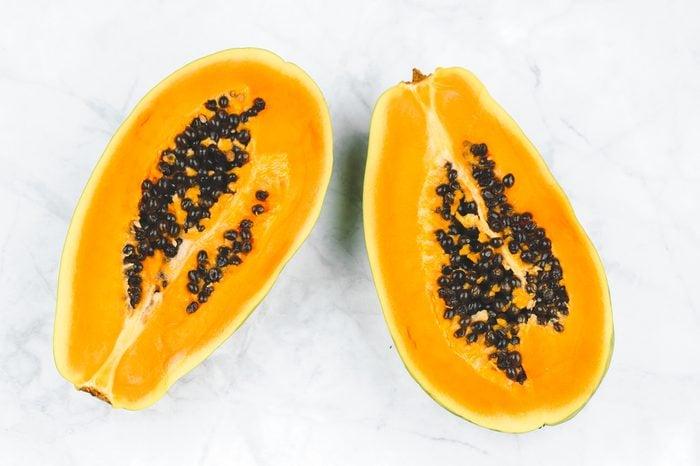 Fresh papaya cut in half