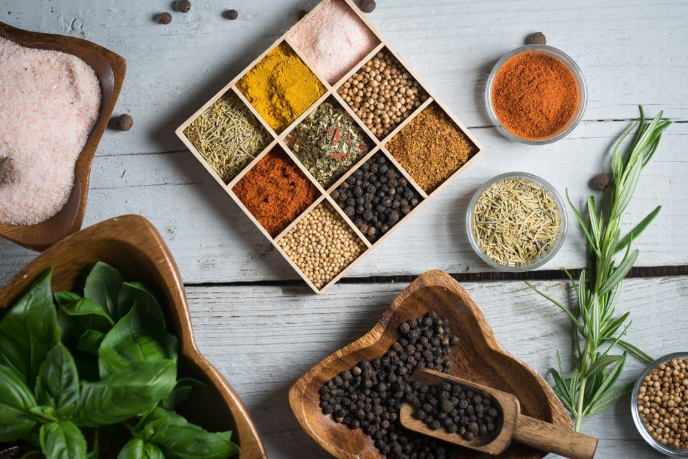 A variety of colorful spices and fresh herbs