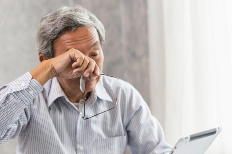Older man with eye irritation