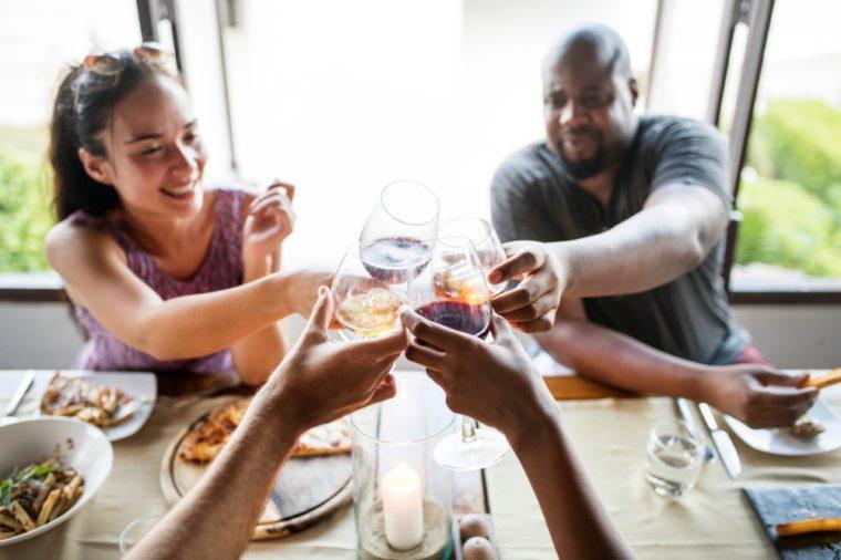 Friends drinking wine in a restaurant.