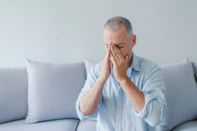 Man with severe headache migraine.