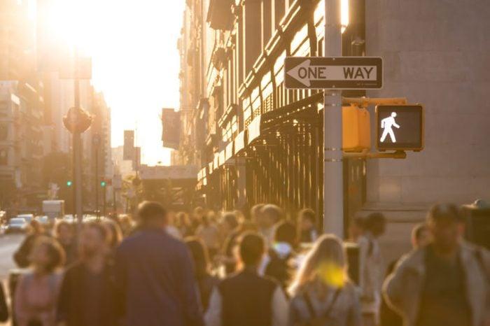 blurred pedestrians walking in city