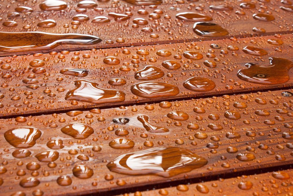 water droplets on wooden deck