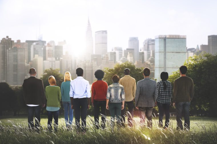 group of diverse people overlooking city scape
