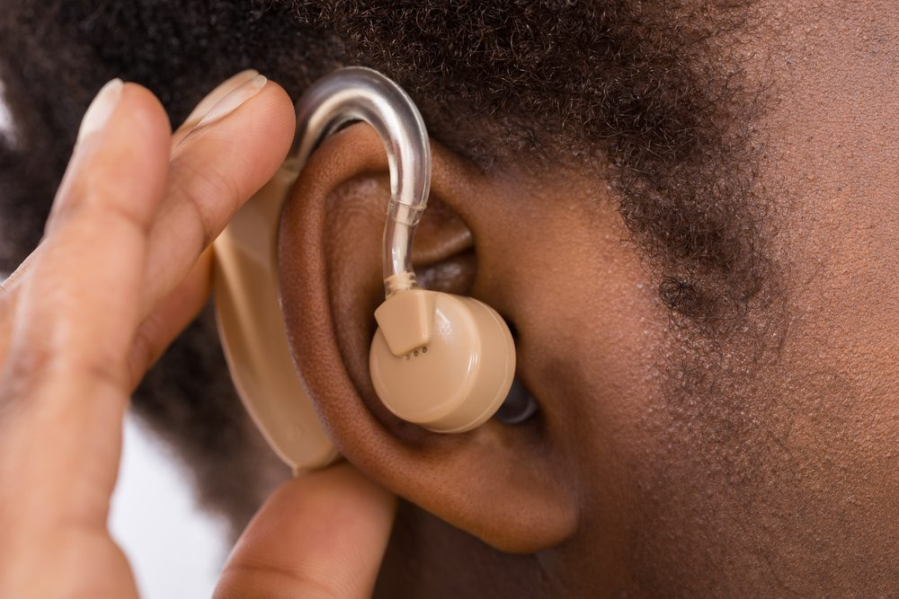 Close-up of woman wearing hearing aid in ear