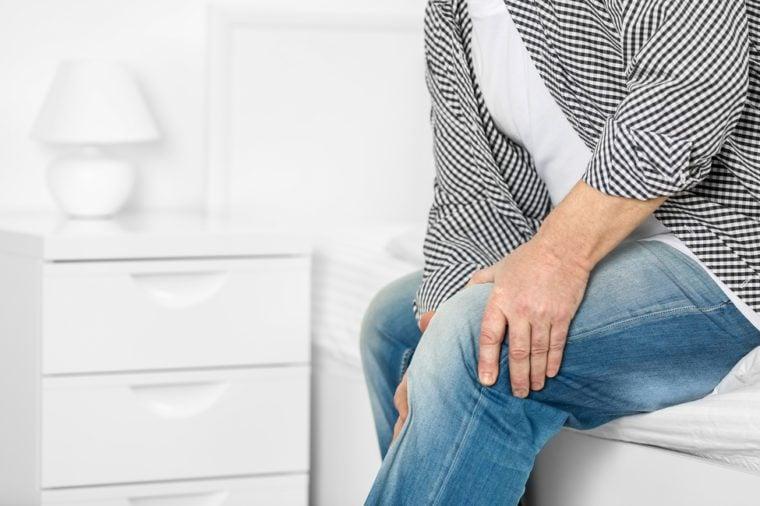 Mature man suffering from leg pain