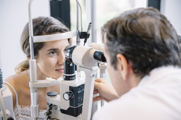 Eye Doctor examining a young patient