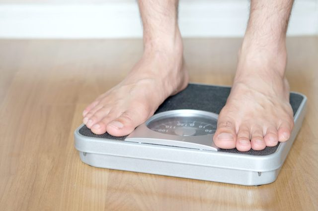 Man standing on scales.