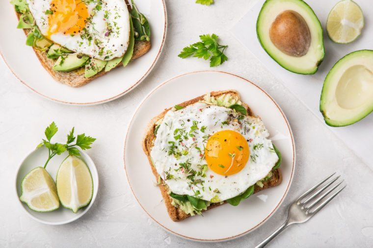 Toast with avocado, spinach and fried egg.