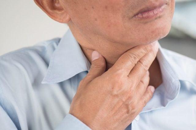 Man with sore throat, laryngitis and reflux