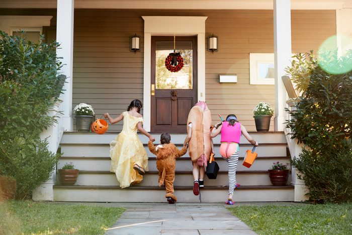 Children Wearing Halloween Costumes For Trick Or Treating