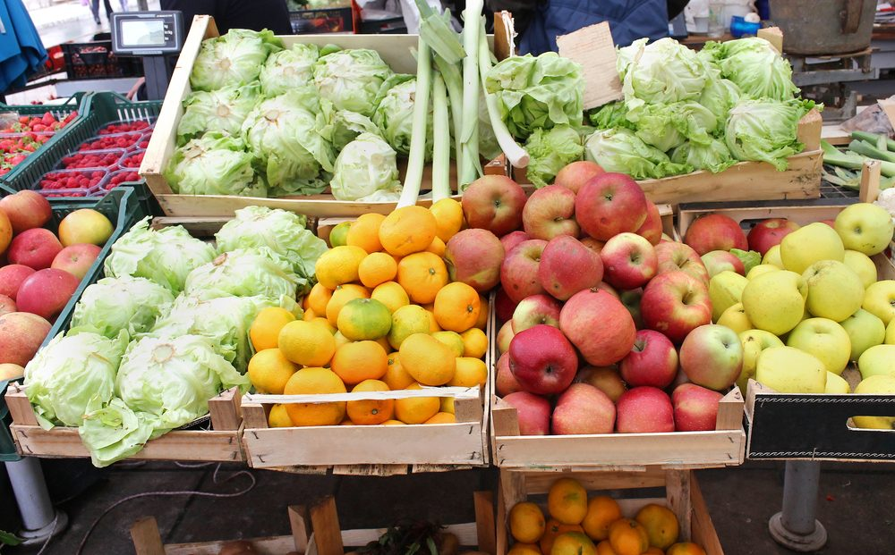 fresh fruits and vegetables at a farmer's market stall