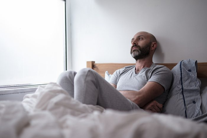 sad or sick man in bed