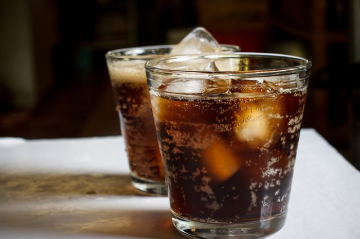 two icy glasses of cola