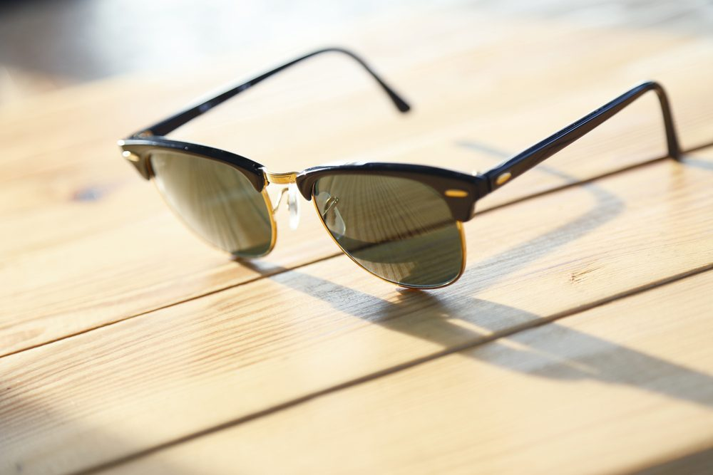 sunglasses on a wood table