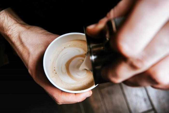Barista making coffee latte art
