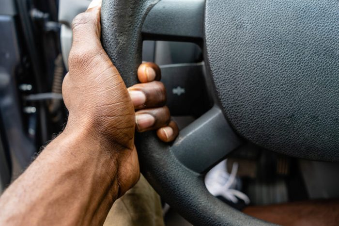Hand holding steering wheel