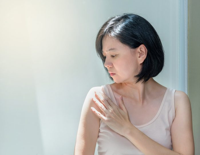 woman looking at her shoulder