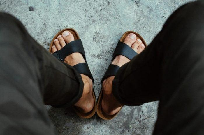 Male feet in sandals