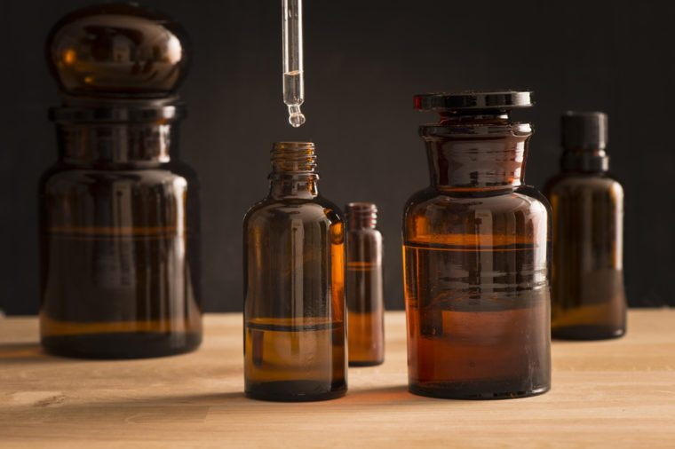 Old style medicine glass bottles with tea tree oil