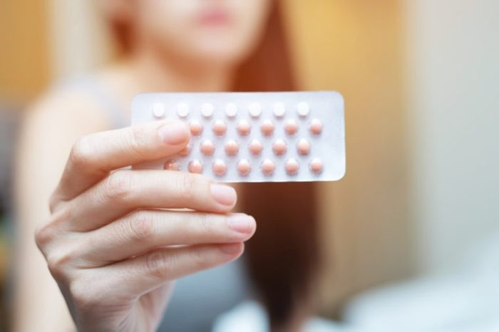 Contraceptive Pill Woman hands opening birth control pills