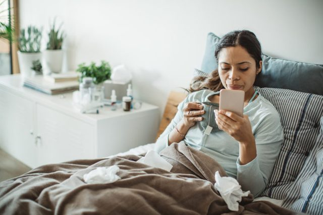 woman in bed sick with a cold