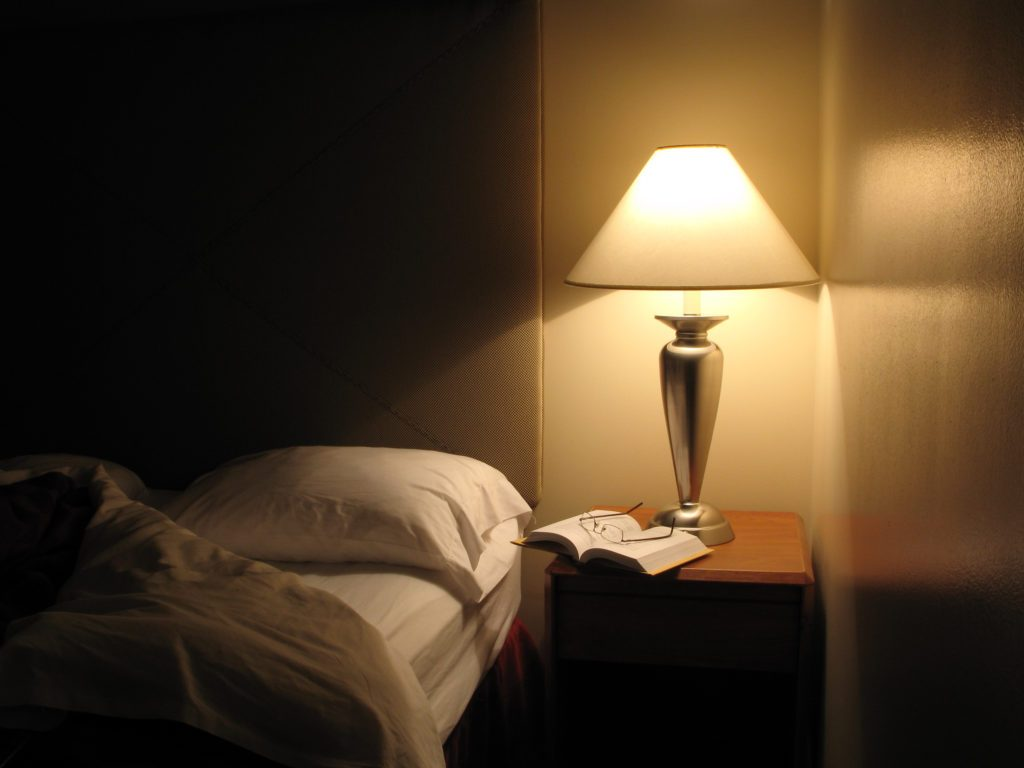 bedroom at night with lamp light on