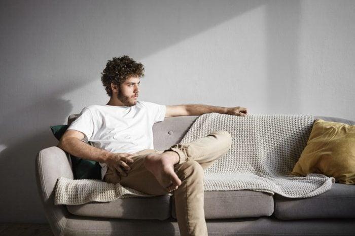 sad man sitting on couch