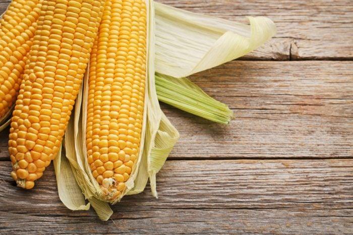 Sweet corns on grey wooden table