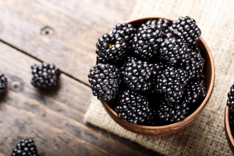 Blackberry on a wooden background