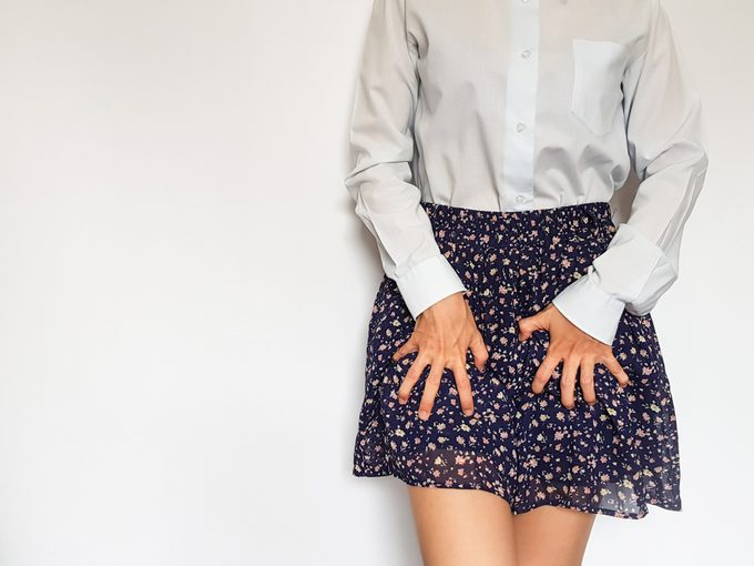 woman with hands on skirt