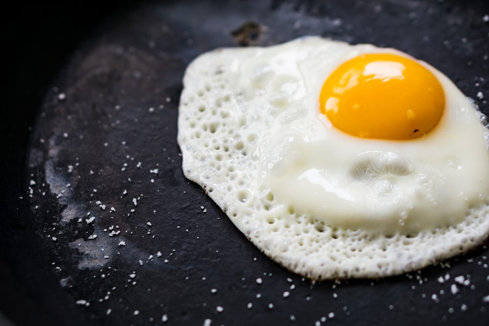 fried egg on black surface