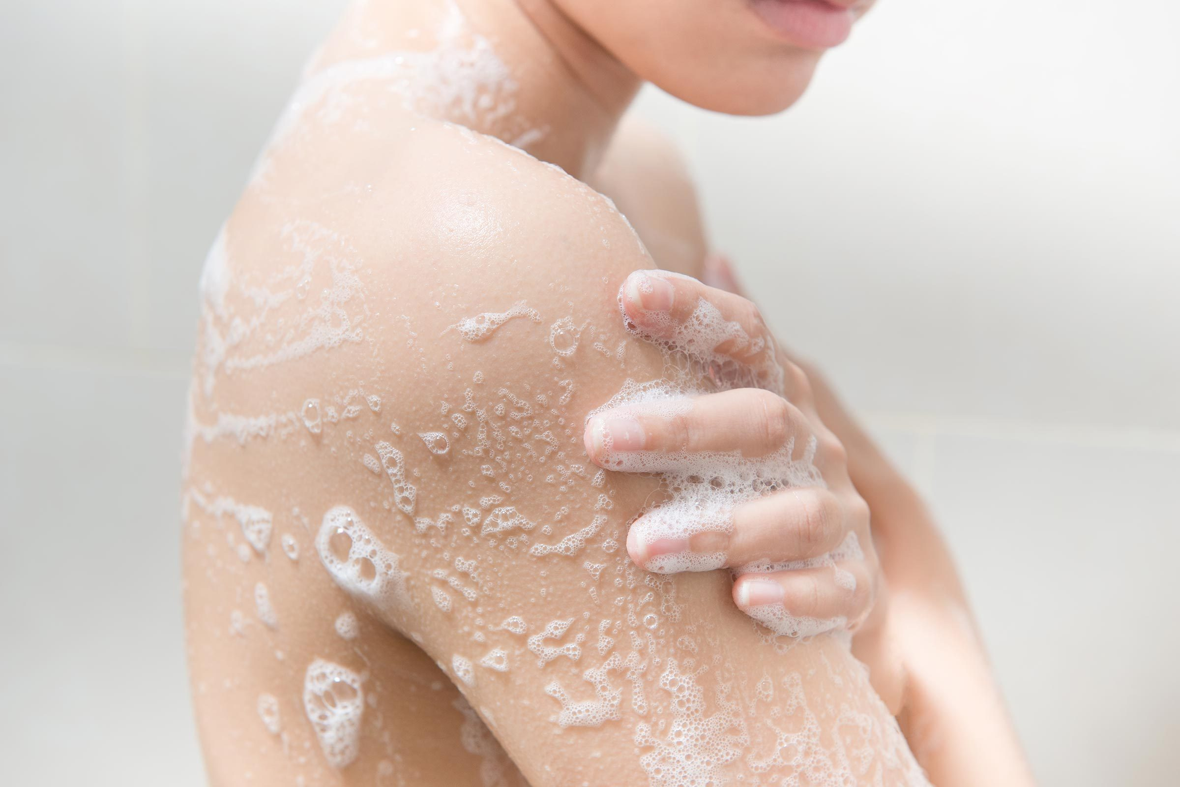Woman showering and soaping up