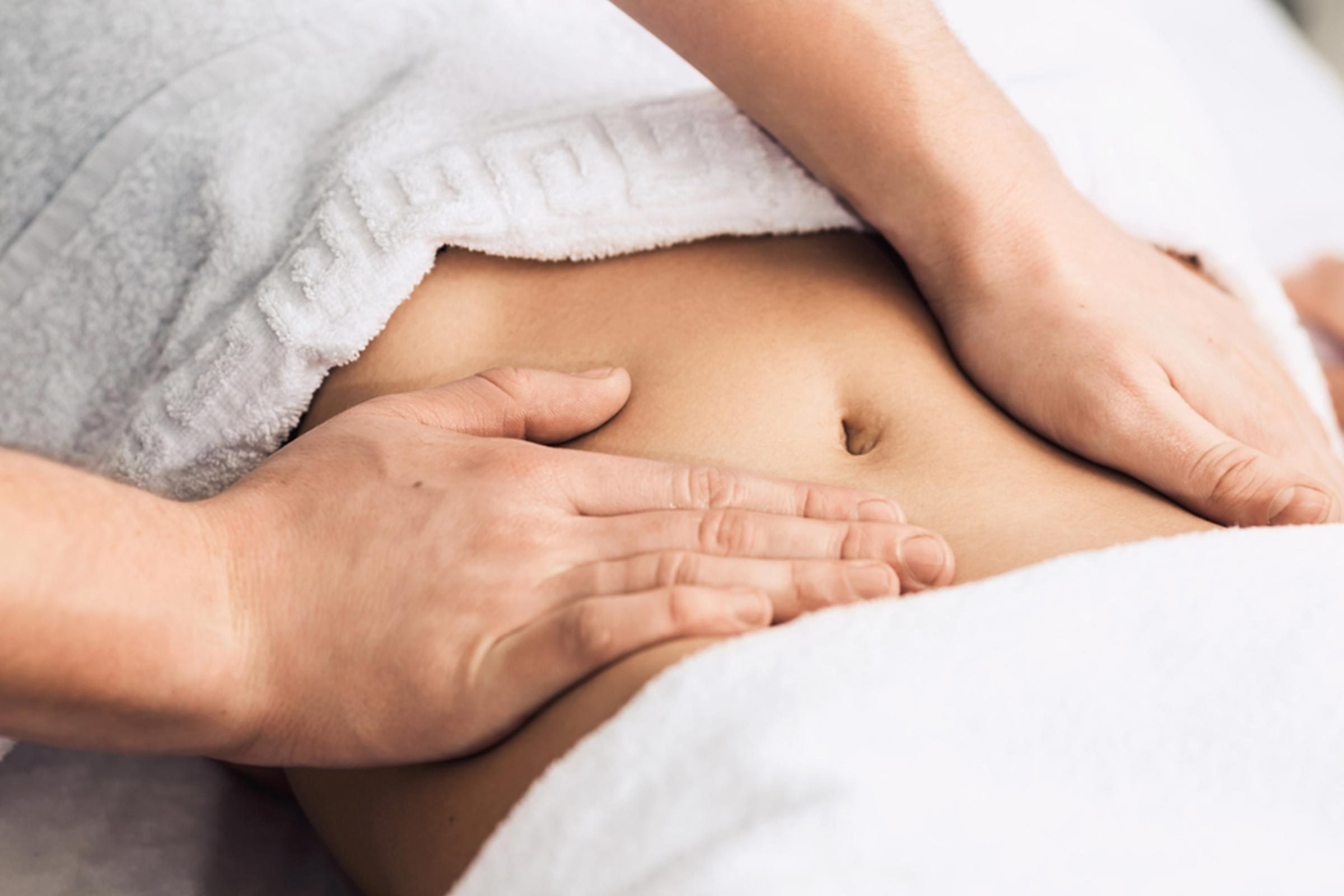 woman with hands on her abdomen